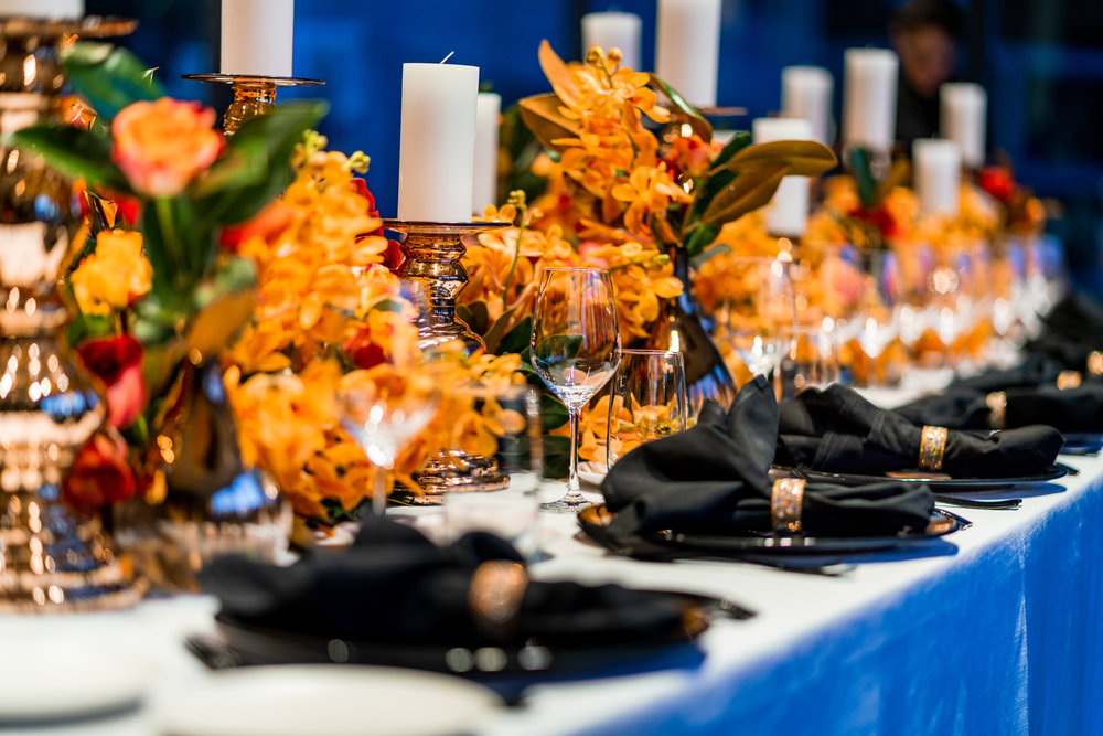 corporate_event_design_events_by_nadia_fresh_flowers_orange_inlighten_photography_black_charger_plate_cutlery_candle_stick_gold_napkin_ring_2.jpg