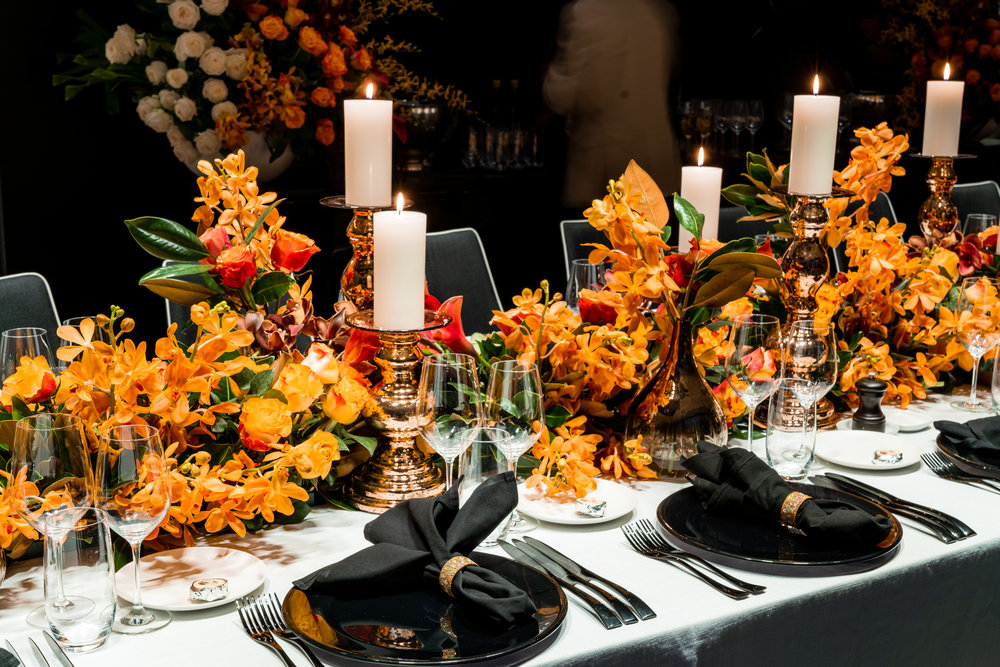 corporate_event_design_events_by_nadia_fresh_flowers_orange_inlighten_photography_black_charger_plate_cutlery_candle_stick_gold_napkin_ring_5.jpg