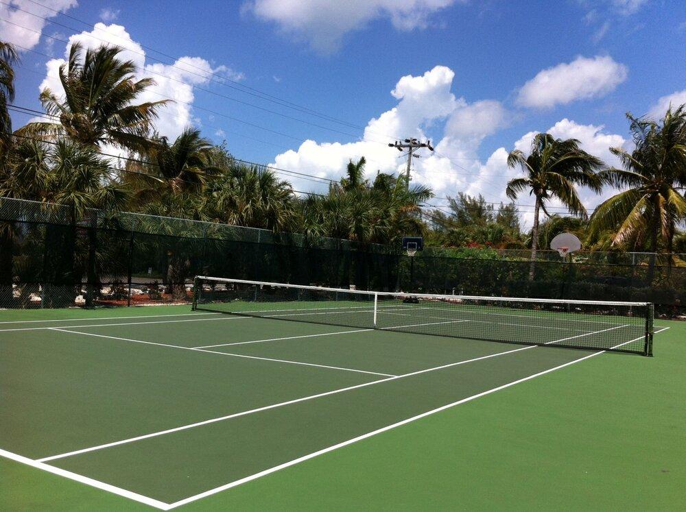 CocoPlum-Exterior-06-Large-Tennis-Court.JPG