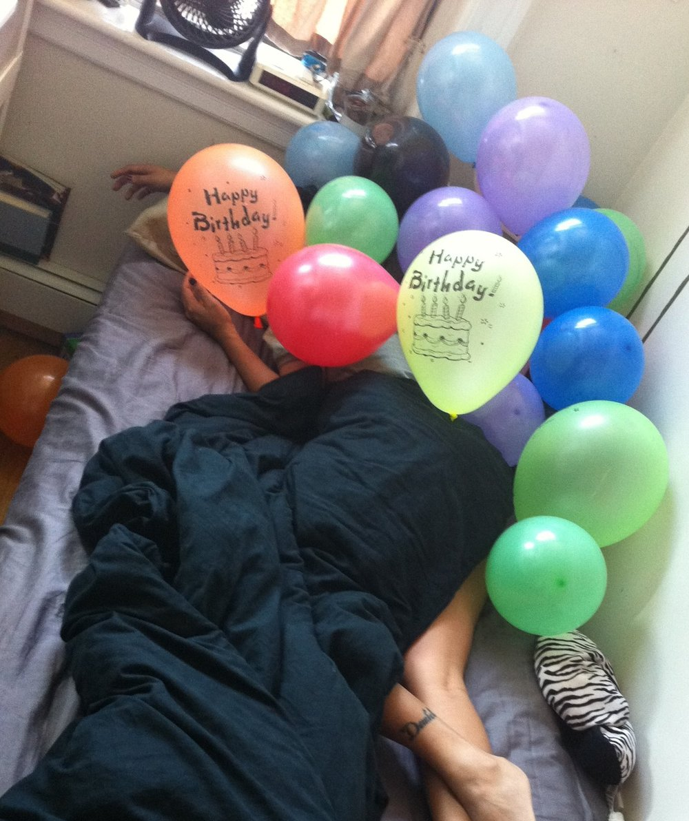 Roommates surprised me on my birthday by filing my tiny room with balloons.