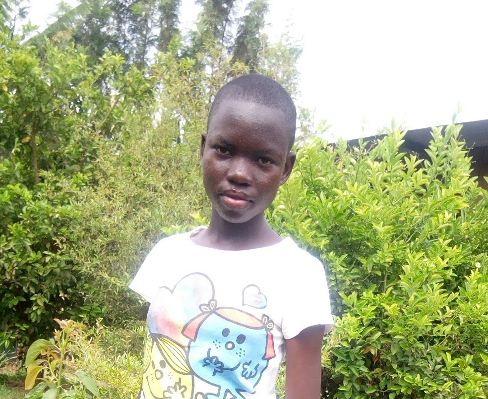 Hadija - Jambo! Jambo! My name is Hadija, I am fourteen years old. I like eating chapati and beans, I enjoy doing Yoga. What makes me happy is learning new skills. I don't enjoy being sick. When I grow up I would like to become an engineer.