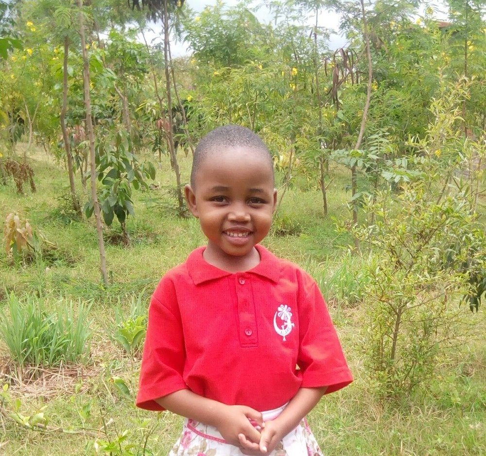Lightness - Jambo! Jambo! My name is Lightness, I am 4 years old. I like eating rice with beans. I enjoy singing school songs and Yoga. What makes me happy is playing with my friends. I don't enjoy when I feel hungry. When I grow up I would like to become a teacher.