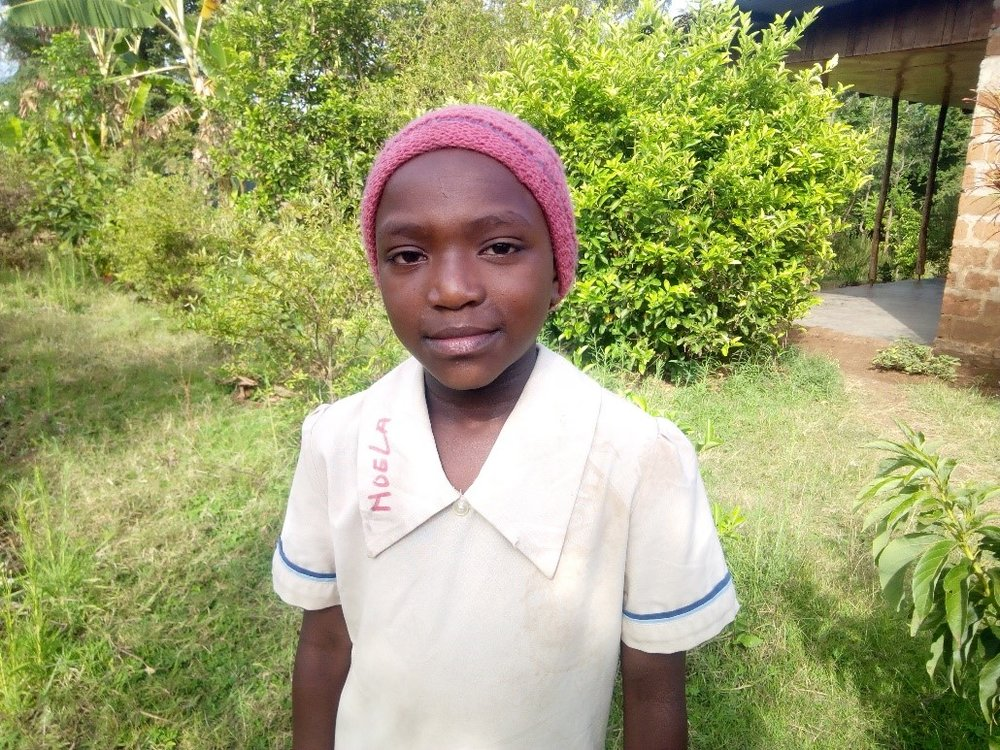 Noela - Jambo! Jambo! My name is Noela, I am 11 years old. I like eating pasta with beans. I enjoy Yoga. What makes me happy is playing with my friends. I don't enjoy when I miss school. When I grow up I would like to become a nurse.