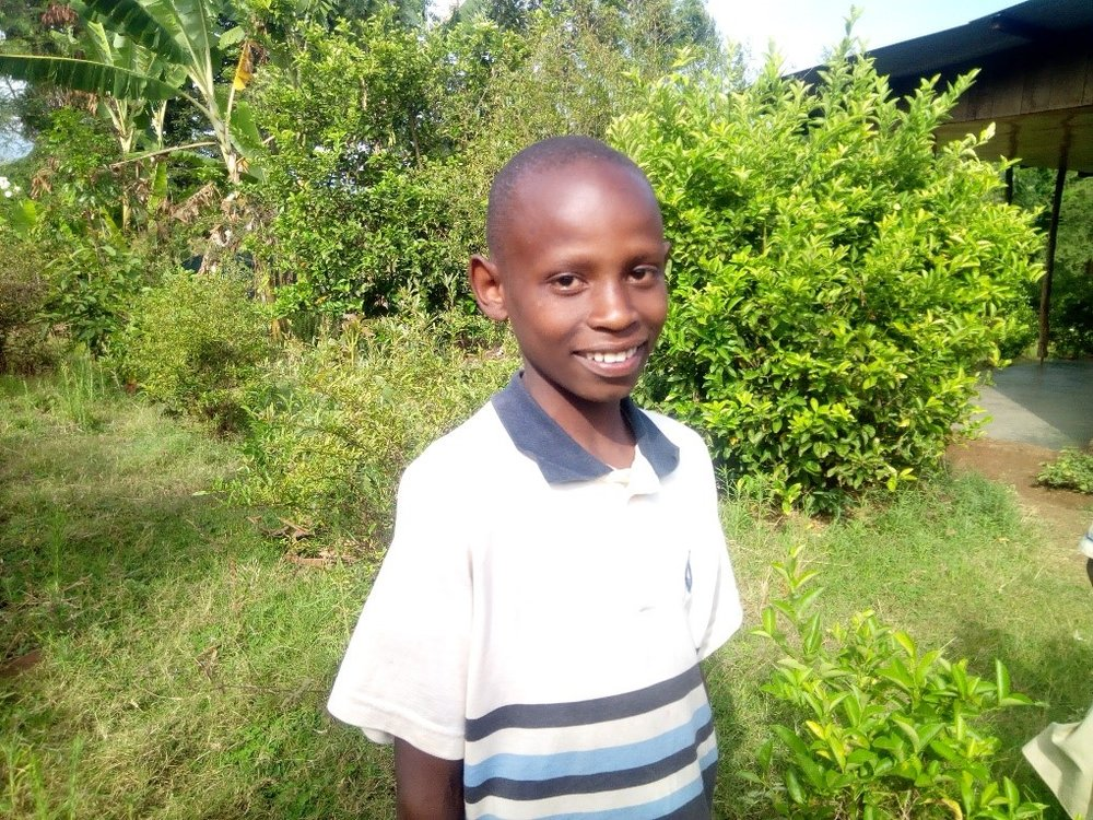 Goodluck - Jambo! Jambo! My name is Goodluck, I am 12 years old. I like eating pasta with beans. I enjoy doing Yoga. What makes me happy is helping in farm. I don't enjoy when I get sick. When I grow up I would like to become a farmer.