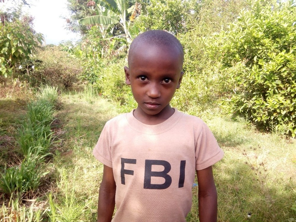 Elisha - Jambo! Jambo! My name is Elisha, I am 6 years old. I like eating banana with beef. I enjoy playing games. What makes me happy is watching pictures in books. I don't enjoy playing alone. When I grow up I would like to become a teacher.