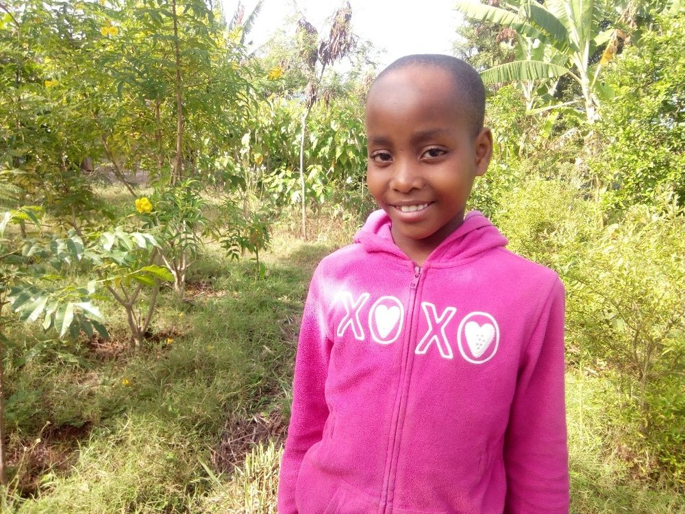 Jackline Tarimo - Jambo! Jambo! My name is Jackline Tarimo, I am 11 years old. I like eating rice with beans. I enjoy doing Yoga. What makes me happy is helping my young sisters at Kili kids. I don't enjoy when am not clean. When I grow up I would like to become a Teacher.