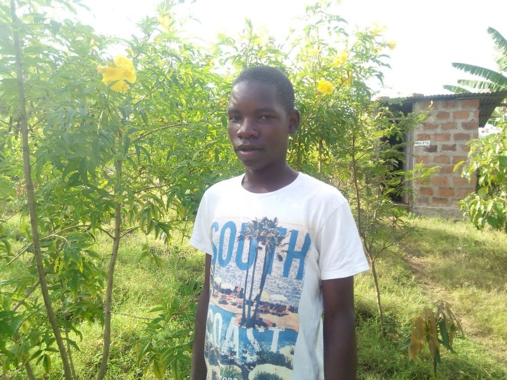 Samwel - Jambo! Jambo! My name is Samwel, I am 15 years old. I like eating chicken chips. I enjoy studying, watch football. What makes me happy is making stories with friends. I don't enjoy when I fail in class. When I grow up I would like to become a Pilot.