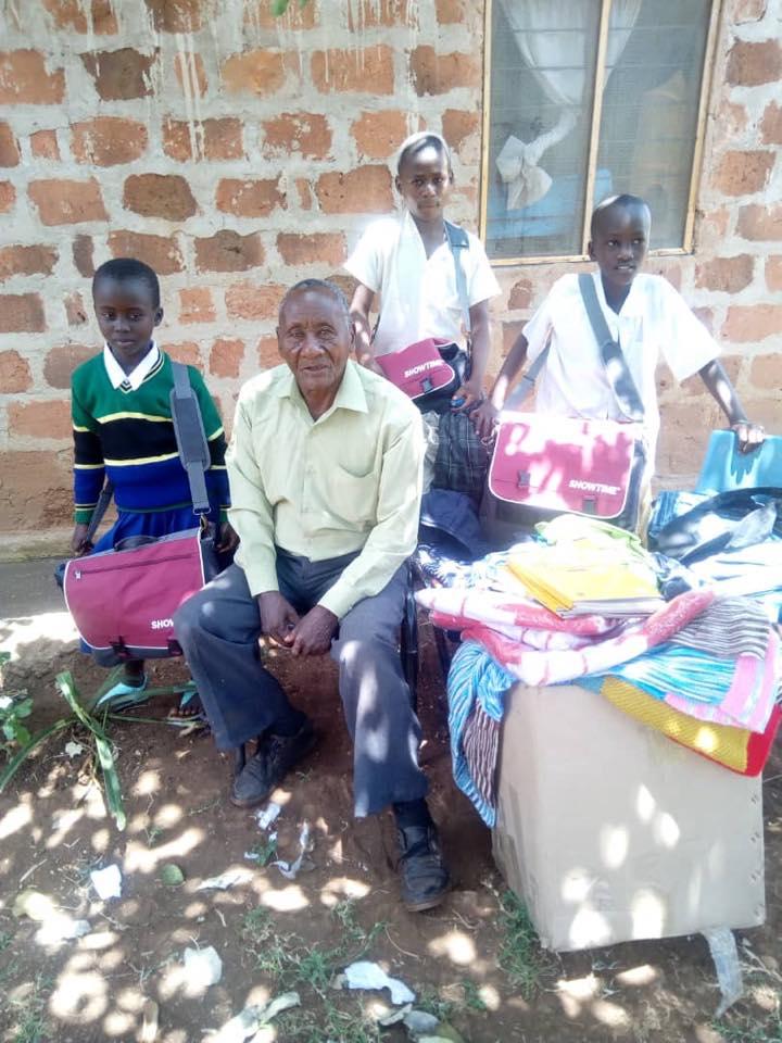 Ester, siblings back with grandpa.jpg
