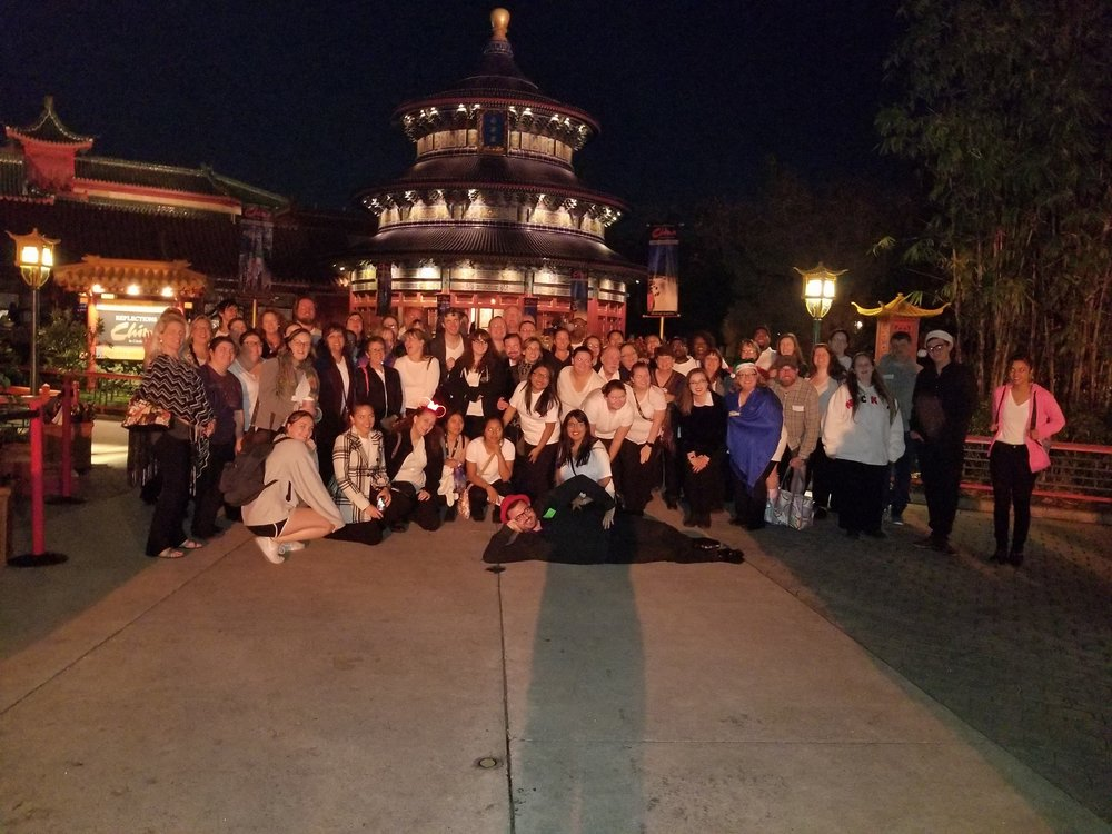 Our community chorus posing for a group photo in the China Pavilion at Epcot in 2017.