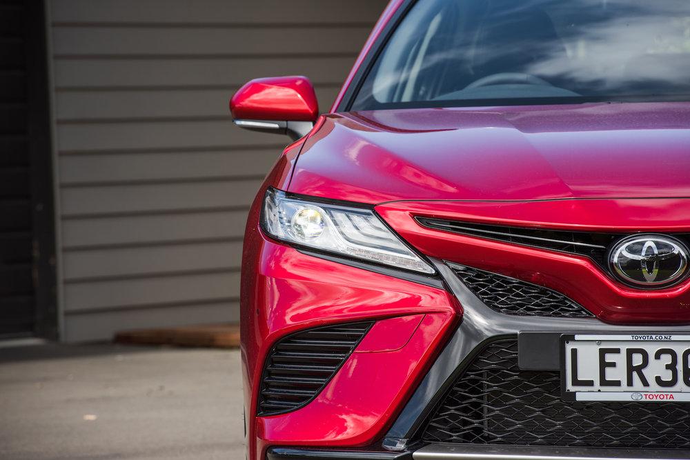 2018 Toyota Camry, V6 petrol engine, pursuit red, front close up shot.jpg