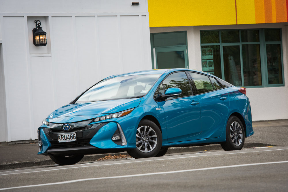 2018 Toyota Prius Prime, Blue magnetism, front three quarter shot, parked.jpg