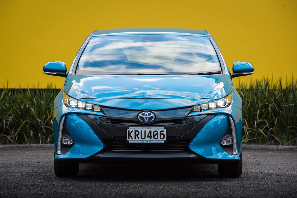 2018 Toyota Prius Prime, Blue magnetism, front shot, yellow wall.jpg