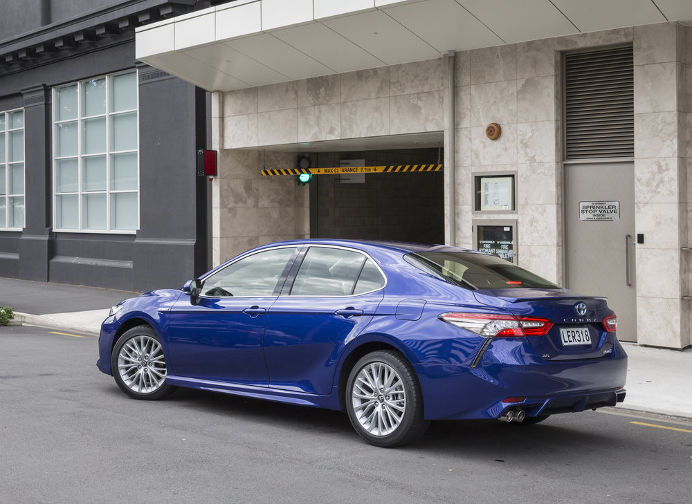 2018 Toyota Camry, ZR hybrid, blue crush, rear three quarter shot.jpg