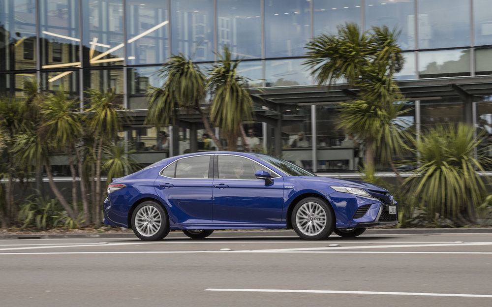 2018 Toyota Camry, ZR hybrid, blue crush, side profile shot.jpg