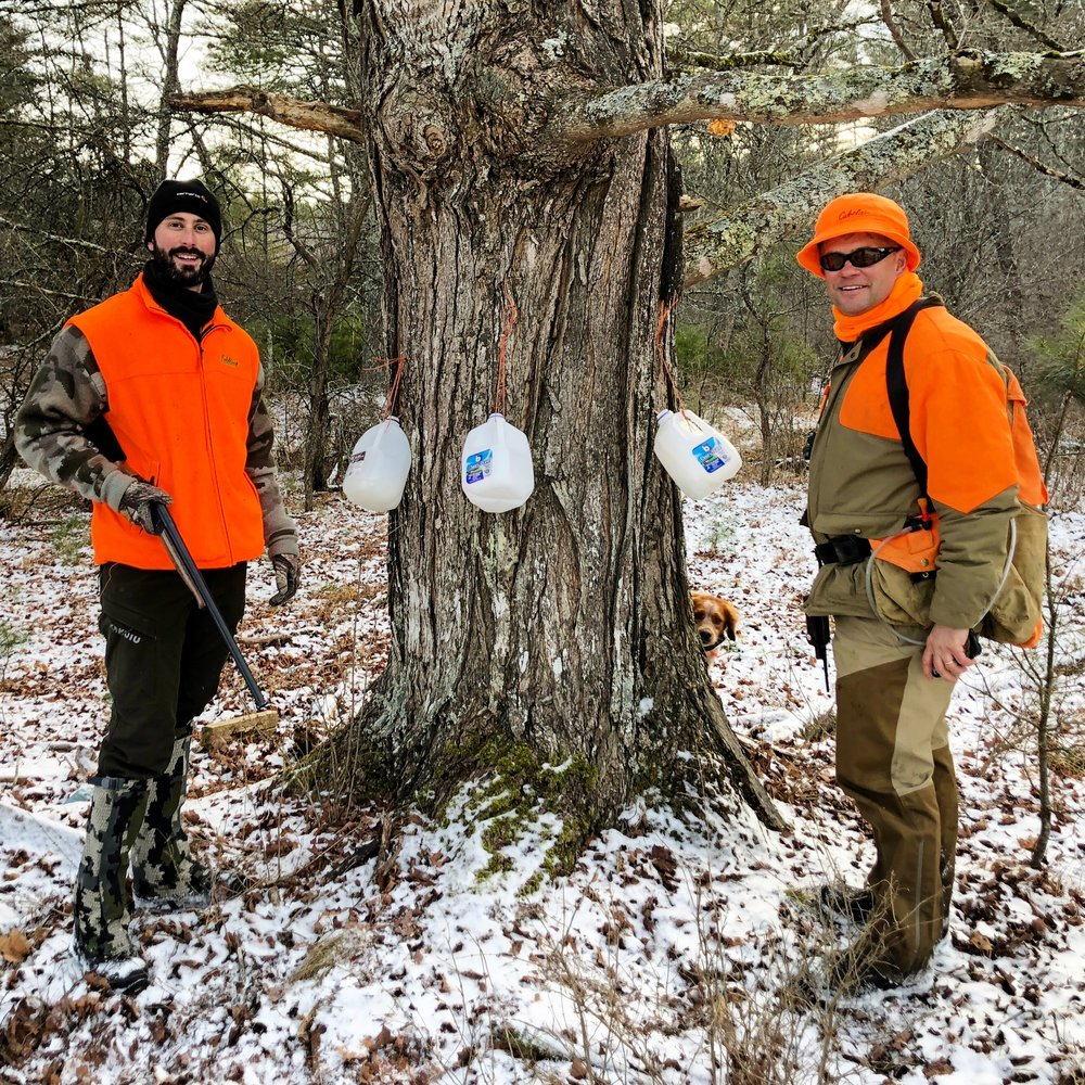 Justin, Chip, and a photo-bombing French Britt posing with an ancient maple, tapped for maple sugar water. One gallon of maple syrup requires fifty gallons of maple sugar water!