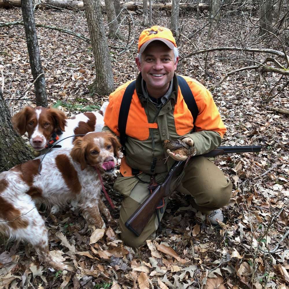 Chip with the first bird of the day, Chip's French Britt, Kona (foreground), a woodcock finding machine, and Lincoln (background), looking on like a kid who had suddenly decided to move from the back of the class to the front row, with new glasses, eager to learn …