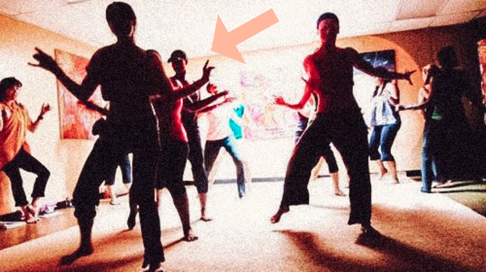 That's me. In the baseball cap. And awkward wide-legged capris... In a super sensual Expressive Yoga Dance® Teacher Training. Yeahhhh…
