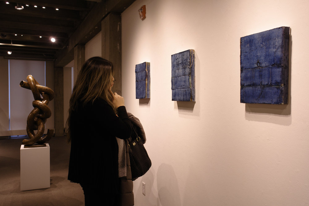 Tzu-Ju Chen with Neal's indigo paintings. These were created with canvas soaked in an indigo dye bath.