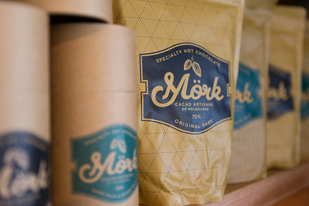 Mork Specialty Hot Chocolate bags and canisters on display
