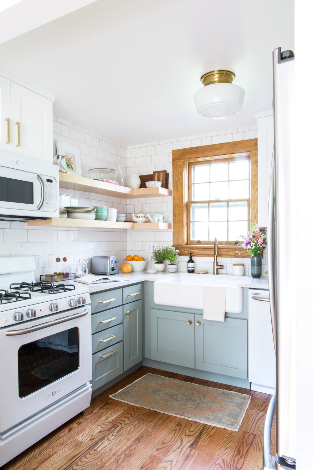 via  The Happy Tudor  -- I love this house! They actually combined a white stove + dishwasher with a stainless refrigerator and it looks amazing!