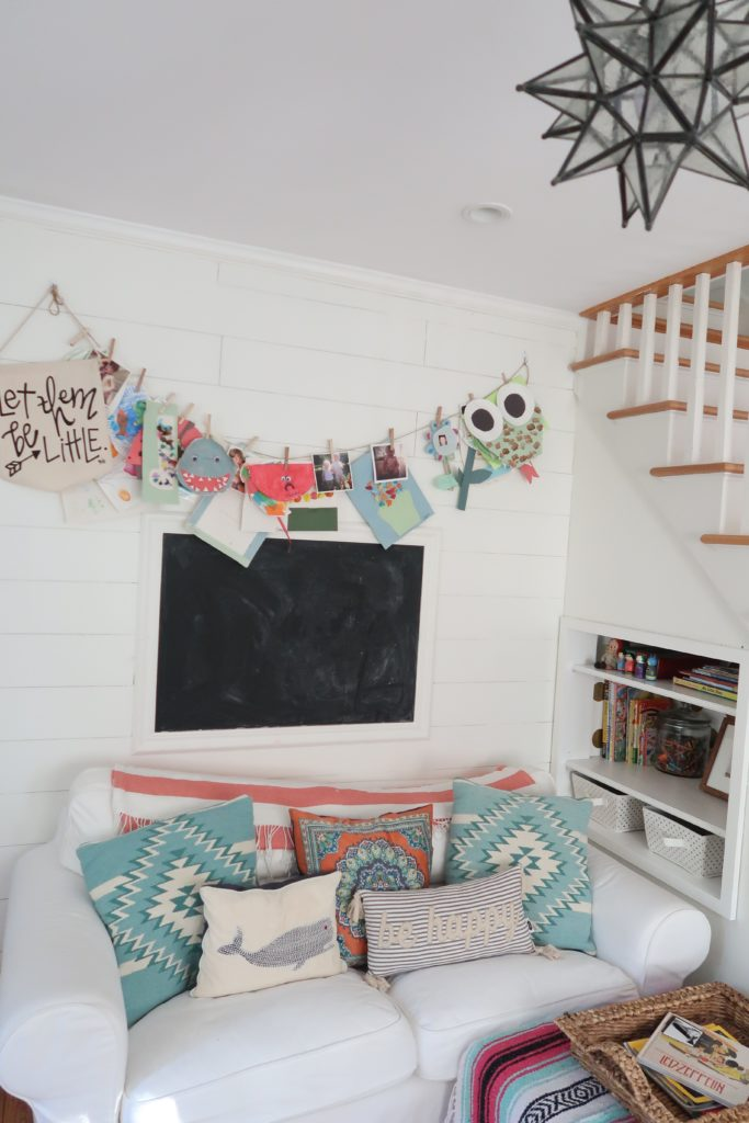 Children's art displayed - photo by  A Happimess Life via Project Nursery