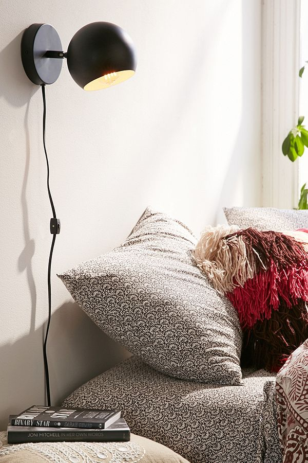 4.) Plug In Sconces/ Pendants - Adding some plug in wall sconces (like this one from Urban Outfitters) is a great way to make a space feel more custom.  In our last rental, I was able to use command strips to attach two sconces on either side of our bed.  They also sell pendant lights that you can hang from the ceiling (again with a command hook- no damage) and plug in.  If you happen to find a pendant light that is only made to be hardwired, I found this awesome tutorial to show you how to make it a plug in.  AND if your apartment has one of those awful ceiling lights that they all seem to, I found this tutorial on how to temporarily make it look a million times nicer!!  Just remember: make sure to save anything you take down from your rental so you can make sure to put it back at move out!