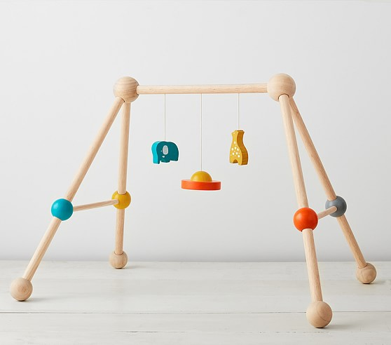 2. Wooden Activity Gym - This wooden play gym from Pottery Barn Kids is so cute! All you need to do is lay down a blanket and you're set!
