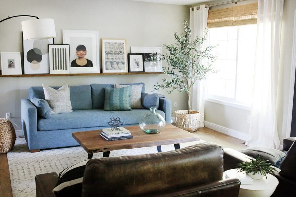 Christ & Julia of Chris Love Julia made this  DIY Art Ledge  to fill the space above their couch