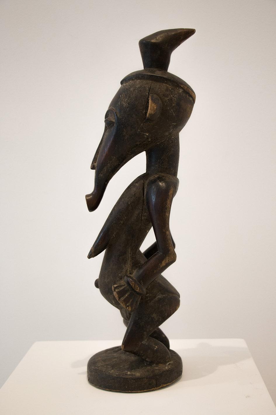 Costa de Marfil  Figura de mujer Senufo  Finales del s.XIX  Talla en madera  55 x 18 cm