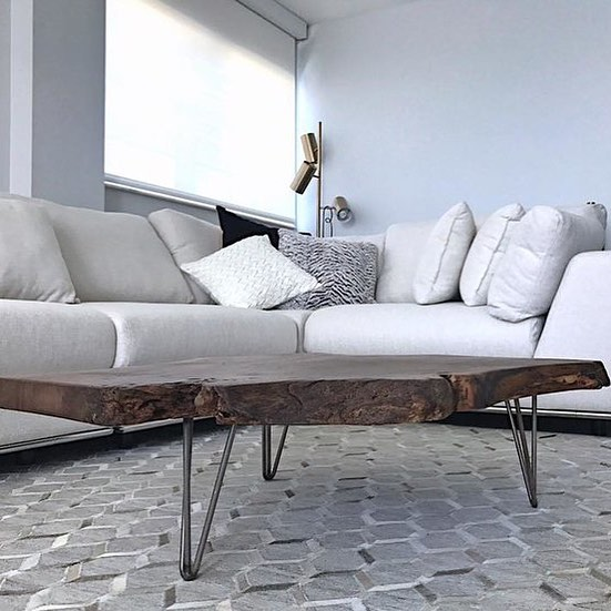 Make an ultra modern space feel like home instantly with natural edge wood!  This is our edged out Black walnut slab with hair pin legs!  Gorgeous!  Contact us today to create your own! #miami #miamibeach #naturaledgewood #naturaledge #liveedge #liveedgetable #modern #interiordesign #livingroom #decorating