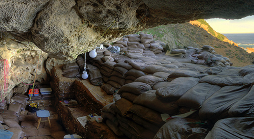 Early human home. A cave in South Africa, where shell middens were found. Photo Credit: Skymotion Video