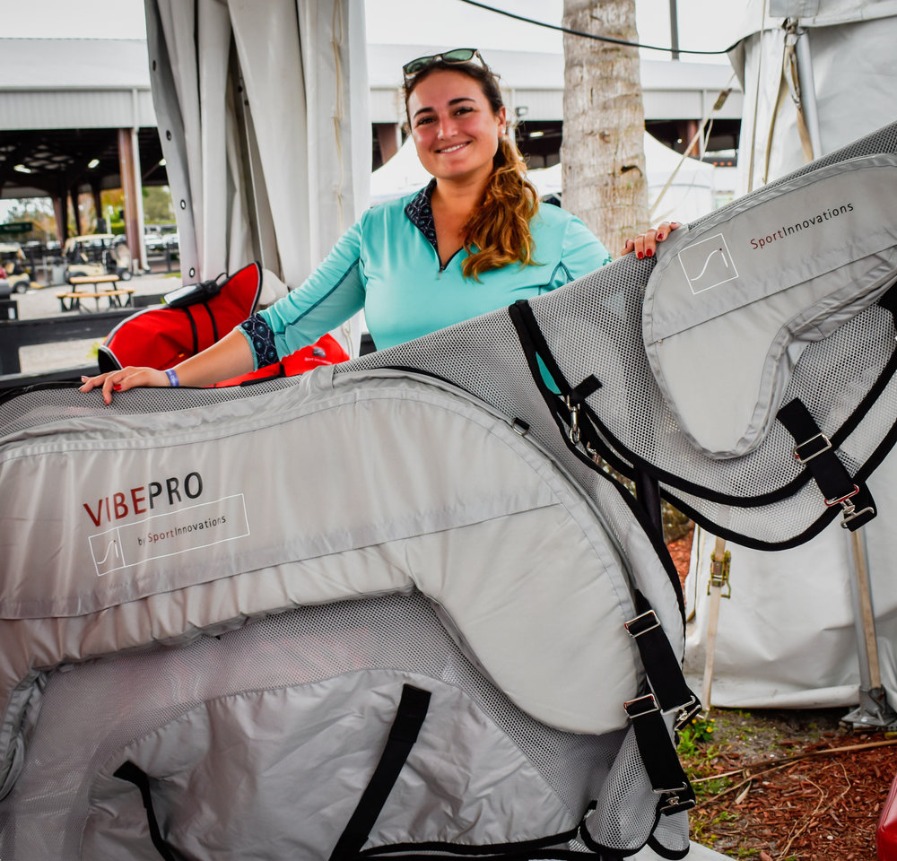Emily poses with a Vibe Pro unit at Adequan® Global Dressage Festival 2019 in Wellington, Florida.