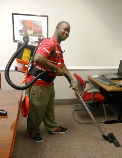 Beyan Johnson, Owner of Amazing Cleaning Service, using his energy-efficient, HEPA-certified vacuum back paid for with a Challenge mini-grant.
