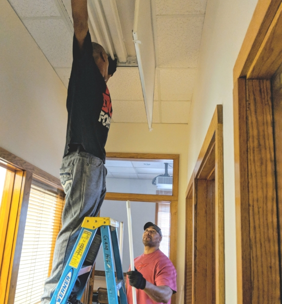New LED bulbs being installed at the SELC office!