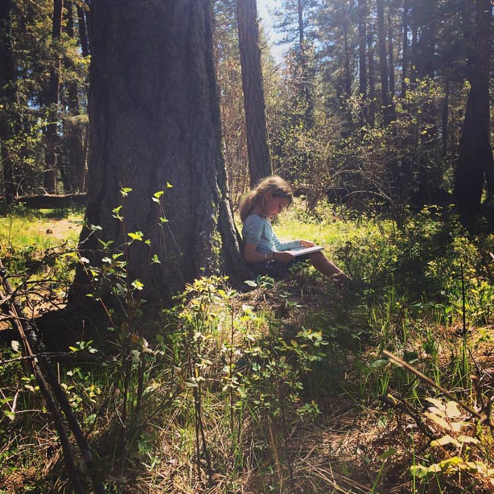 reading in the woods.jpg
