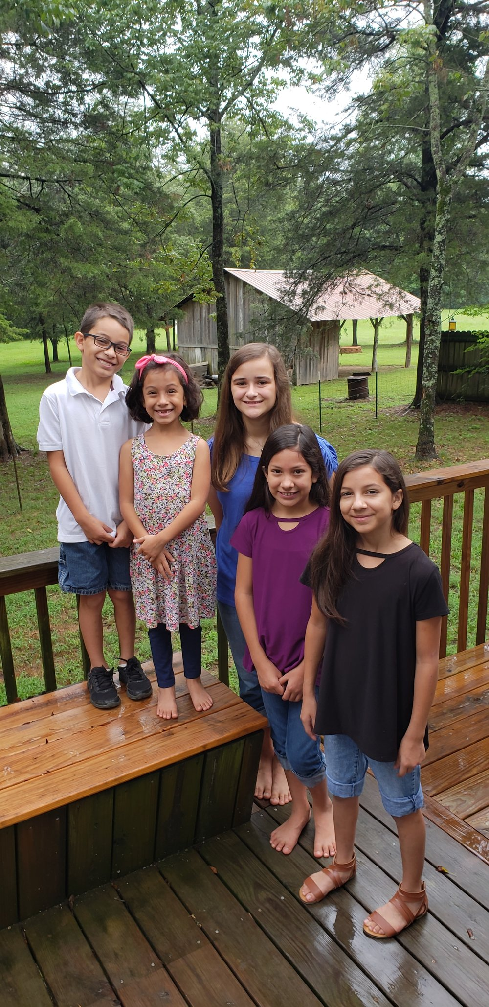 First day of school! - ...and Tanja's 20th year of homeschooling. Please pray for grace, guidance, strength and wisdom as we raise this family and teach the the way of the Lord.AND...would you please pray for our children? [in the picture from L to R, Bryan, Elly, Jillian, Josie and Jalynn] Please pray for them as they learn to read, write, add, subtract, etc. Please pray that they grow to know their God better each day. Pray for protection from the strategies of the enemy to derail and destroy the perfect plan of the Lord for their lives.ALSO, please pray for our three older children: SHELBY, who is in grad school at Harding and a grad assistant their while living with and helping care for my father and mother (who has Alzheimers); BETHANY, who is living with us while finishing out her midwifery requirements and looking into potential future work in a persecuted country in Central Asia; ROBBIE, as he works and finishes his last semester at the community college in Kansas City (and also anxiously awaiting a visa for his bride-to-be who is in Albania).