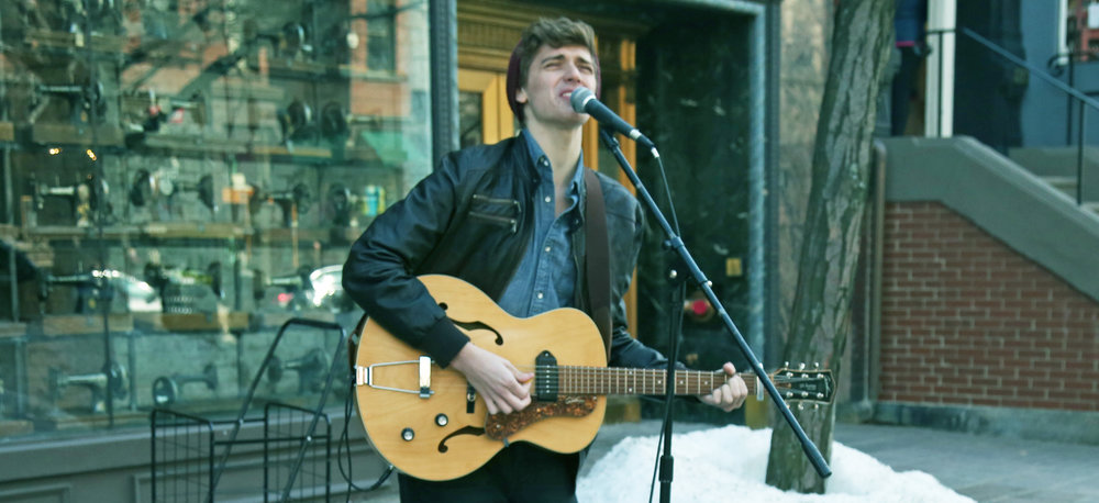 eli busking in snow closeup.jpeg