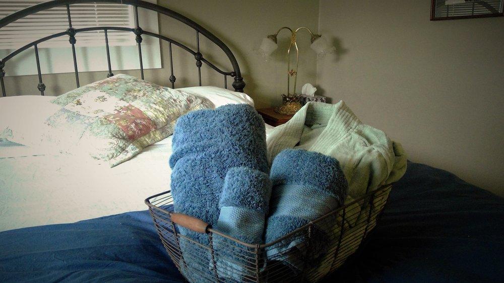Room 1 towel bed.jpg