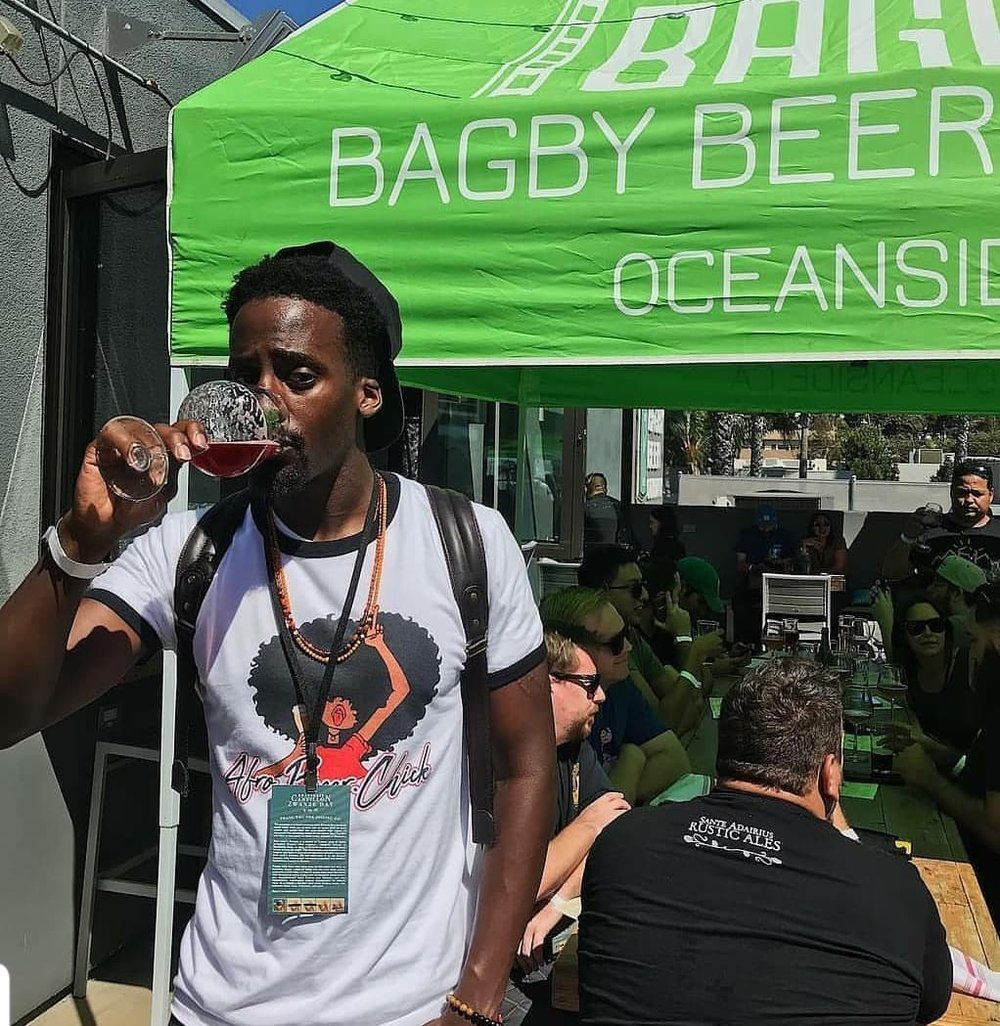 Black Beer Travelers  sipping and rocking A.B.C shirt