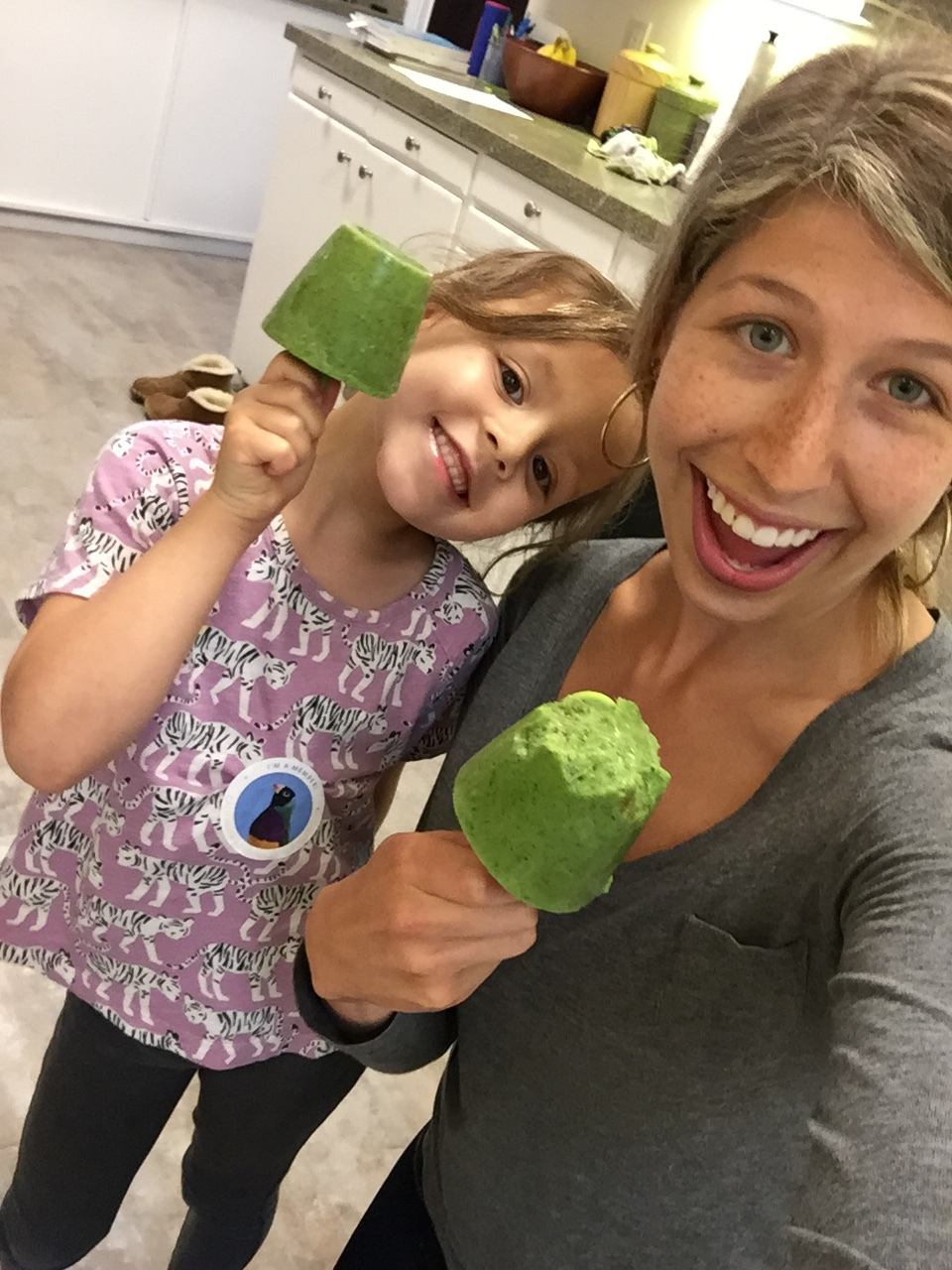 Enjoying a Smoothie Pop! Filled with booster foods for growing kids and healthy adults.