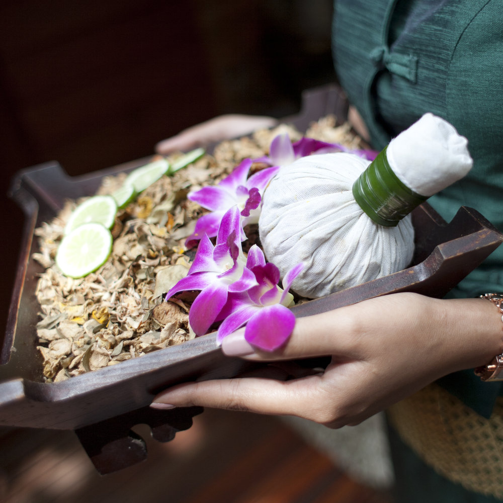 spa-massage-setting-with-thai-herbal-compress-stamps-on-woman-hand_BPdlY6ydnfe.jpg