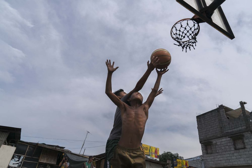 Basketball is the Philippines national sport. Because the game requires little in the way of equipment or space, it appeals to a vast number of impoverished youth who play it on their neighborhood streets.