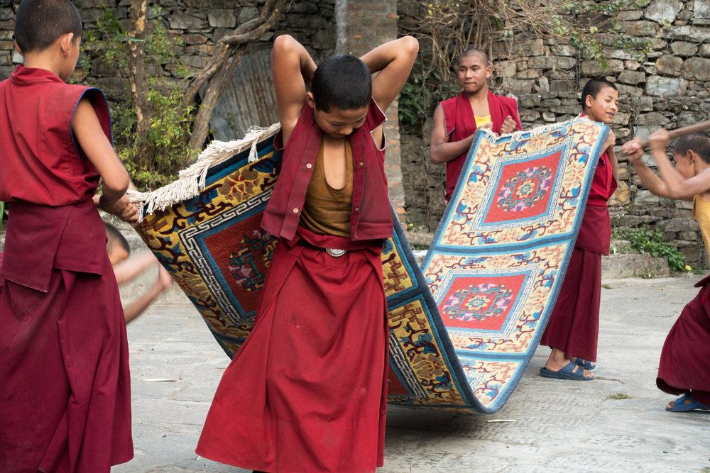 acolytes beat the carpets-  Bhenchen Monastery, Kathmandu