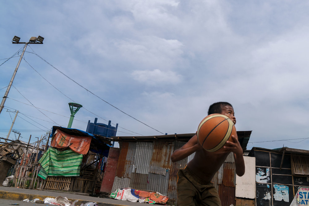 For many boys in  Tondo  the sport of basketball provides some fun using simple inexpensive equipment.