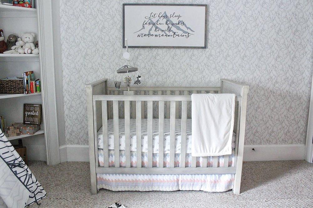 Crib and wallpaper