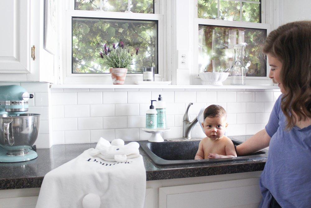 Dominic having a bath