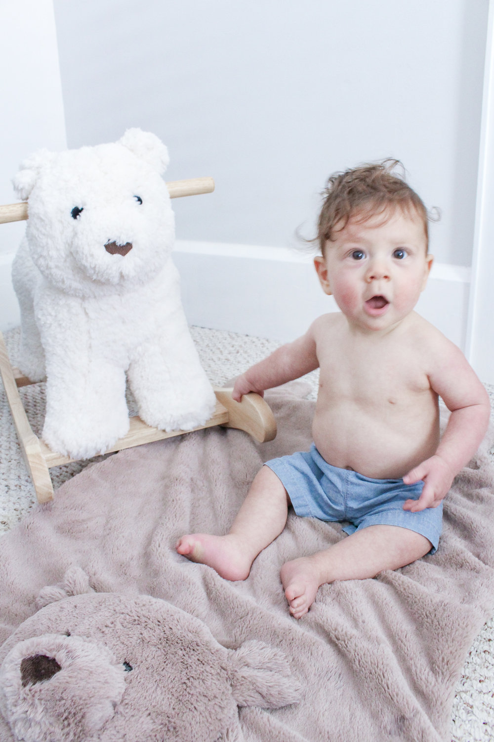 Dominic sitting next to his bear