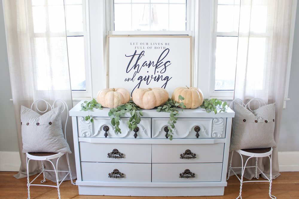 Painted cabinet and heirloom pumpkins