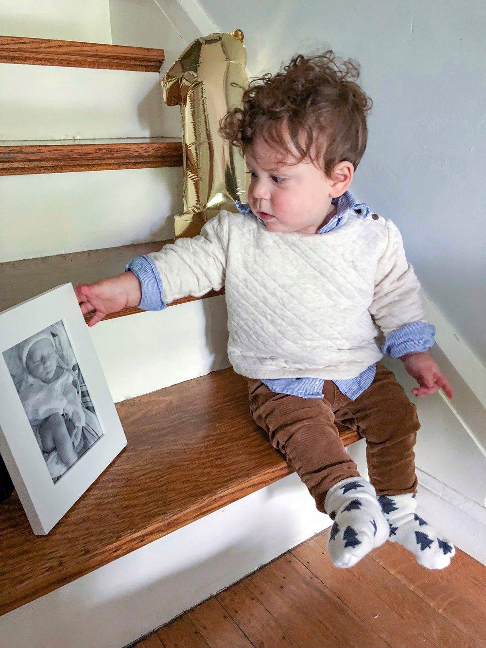 Dominic holding his newborn photo