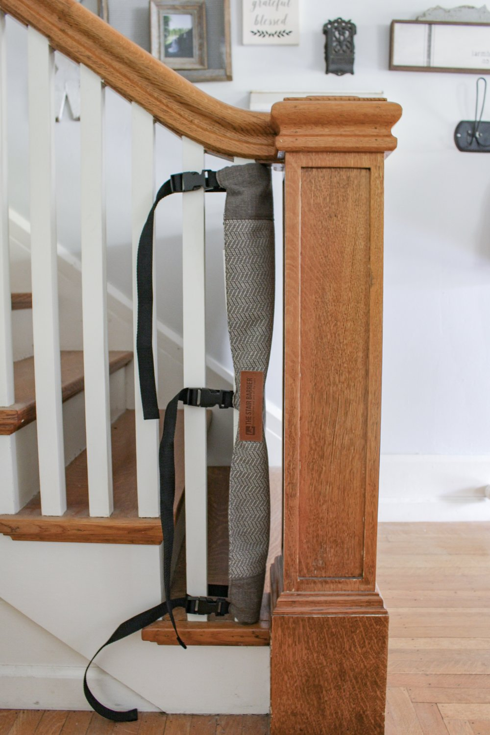 The Stair Barrier buckles for baby proofing the stairs
